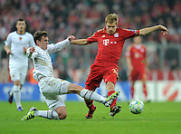 FUSSBALL   CHAMPIONS LEAGUE   SAISON 2011/2012  Achtelfinale Rueckspiel 13.03.2012 FC Bayern Muenchen - FC Basel  Fabian Frei (li, FC Basel) gegen Holger Badstuber (re, FC Bayern Muenchen)