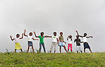 """Members of Nouvel Etwal - Haitian Kreyol for """"New Stars"""" - dance on a hillside in Mizak, Haiti. Nouvel Etwal is a dance and creative movement group of 16 girls from age 8 to 13, based in the southern village of Mizak. According to Valerie Mossman-Celestin, an organizer of the group, """"Nouvel Etwal seeks to empowers girls to be self-confident and creative. The girls learn flexibility, discipline and teamwork, lessons they also need for life. Nouvel Etwal promotes health, well-being and enhanced self-worth. The girls are encouraged to live into a brighter future where girls and women are valued,  educated, and have equal opportunity to achieve their potential."""""""