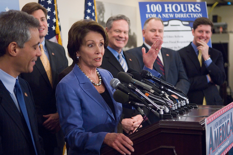 """01/18/07--DCCC Chairman Rahm Emanuel, D-Ill., House Speaker Nancy Pelosi, D-Calif., and other House Democrats during a news conference on the completion of the first 100 legislative hours of the 110th Congress. They touted their """"100 Hours for a New Direction,"""" citing the passage of an ethics package; fiscal legislation; implementation of 9/11 Commission recommendations; an increase in the minimum wage; legislation allowing the expansion of stem cell research; negotiation for prescription drugs; lower interest rates on student loans; and energy legislation. Congressional Quarterly Photo by Scott J. Ferrell"""