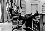 There is nothing formal about United States President Gerald R. Ford with his foot up on the desk as he talks on the telephone from the Oval Office in the White House in Washington, D.C. on August 12, 1974.<br /> Mandatory Credit: David Hume Kennerly / White House via CNP