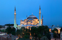 General view of Hagia Sophia, 532-37, by Isidore of Miletus and Anthemius of Tralles, Istanbul, Turkey, floodlit in the evening. Hagia Sophia, The Church of the Holy Wisdom, has been a  Byzantine church and an Ottoman mosque and is now a museum. The current building, the third on the site, commissioned by Emperor Justinian I, is a very fine example of Byzantine architecture. The historical areas of the city were declared a UNESCO World Heritage Site in 1985. Picture by Manuel Cohen.
