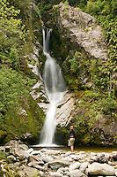 A woman at Dorothy Falls near Lake Kaniere near Hokitika - West Coast