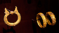 Golden ring with Naga snake heads is displayed in the Southeast Gold Museum that presents hundreds of golden artifacts from the private collection of founder Istvan Zelnik in Budapest, Hungary on September 15, 2011. ATTILA VOLGYI