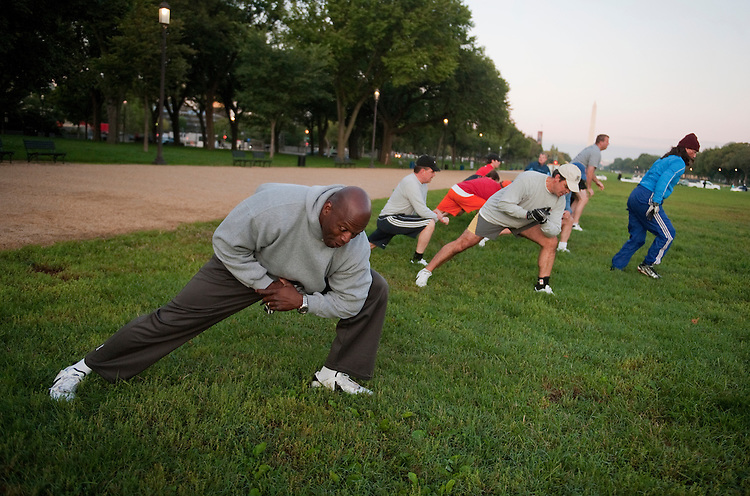 UNITED STATES - OCTOBER 04:  Former Redskin player Ken Harvey, left, leads a congressional football practice on the Mall in preparation for the upcoming game between members of Congress and the Capitol Police.  (Photo By Tom Williams/Roll Call)
