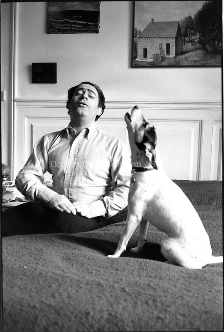 Roland ToporA at home in Paris, singing with his dog.