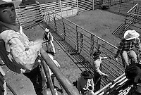 Competitors mill about behind the chutes during the bullriding competition at the annual Lincoln Rodeo in Lincoln, MT in June 2006.  The Lincoln Rodeo is an open rodeo, which means competitors need not be a member of a professional rodeo association.