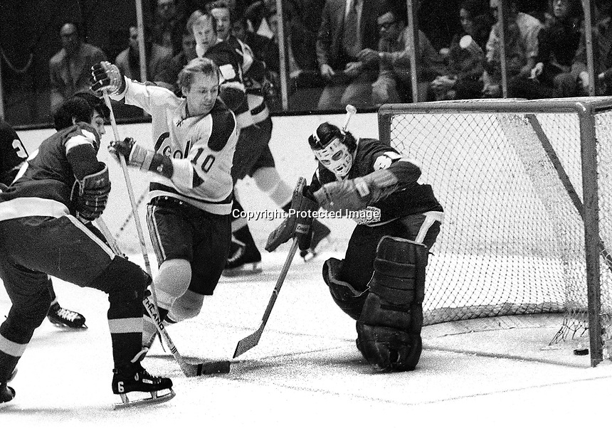 Seals Stan Gilbertson scores  against Red Wing goalie Roy Edwards.<br /> (1971 photo/Ron Riesterer)