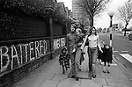 Chiswick Women Aid Shelter for Battered Women. London England 1976. Two mothers and their children who are staying in the hosel walking to local shops.