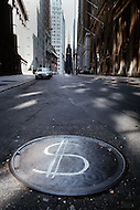 Manhattan, New York City, NY. October 1966.<br /> Dollar sign on manholes symbolizing the economic status after Black Monday, when stock markets around the world crashed.