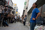 Lines of people at the Apple store await the official release of the iphone4S in Ginza, Tokyo, Japan. Friday October 14th 2011. The latest version of the popular iphone was released worldwide on October 14th. Japans flagship Apple store in Ginza was opened at 8am for the 800 people that had been waiting to be the first to purchase the new telephone.