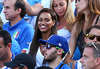 Fanny Neguesha, the fiancee of Mario Balotelli of Italy, smiles in the stands