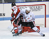 Anthony Bitetto (Northeastern - 7) works to move Joel Malchuk (RPI - 13) as the puck drops down between them and Chris Rawlings (Northeastern - 37). - The visiting Rensselaer Polytechnic Institute Engineers tied their host, the Northeastern University Huskies, 2-2 (OT) on Friday, October 15, 2010, at Matthews Arena in Boston, MA.