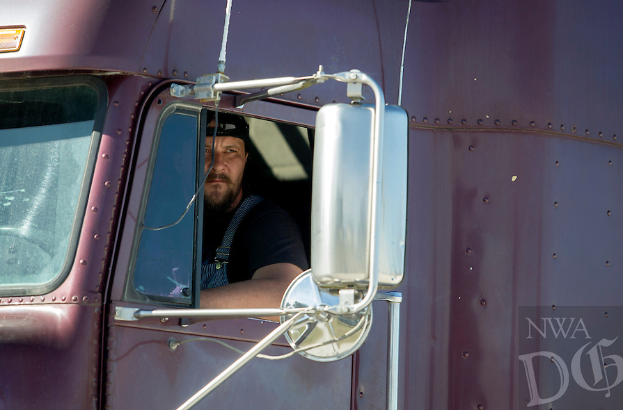 NWA Democrat-Gazette/JASON IVESTER<br /> Greg Campbell of Fayetteville checks his mirror while reversing on a course Wednesday, March 1, 2017, during the CDL class at Northwest Technical Institute in Springdale.