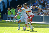 Red Bulls defender Jan Gunnar Solli (8) gets ahead of Sporting KC midfielder Roger Espinoza (15)... Sporting Kansas City defeated New York Red Bulls 2-1 at LIVESTRONG Sporting Park, Kansas City, Kansas.
