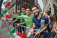 Iranian-American spectators show their ethnic pride at the 11th annual Persian Parade on Madison Ave. in New York on Sunday, April 13, 2014. The parade celebrates Nowruz, New Year in the Farsi language. The holiday symbolizes the purification of the soul and dates back to the pre-Islamic religion of Zoroastrianism. (© Richard B. Levine)