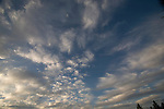 wide angle photograph by Paolo Diego Salcido of clouds in blue sky landscape
