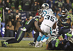 Seattle Seahawks  linebacker Bruce Irvin (51) brings down Carolina Panthers fullback Mike Tolbert (35) in the NFC Western Division Playoffs at CenturyLink Field  on January 10, 2015 in Seattle, Washington. The Seahawks beat the Panthers 31-17. ©2015. Jim Bryant Photo. All Rights Reserved.