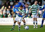 St Johnstone v Celtic.....12.04.11.Emilio Izaguirre and Jordan Robertson.Picture by Graeme Hart..Copyright Perthshire Picture Agency.Tel: 01738 623350  Mobile: 07990 594431