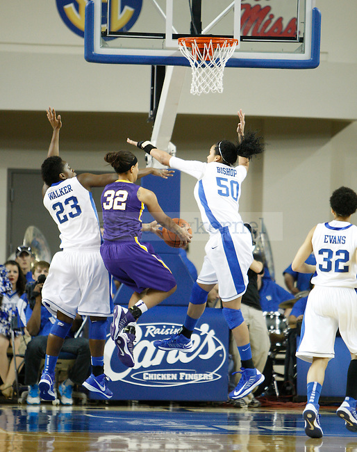 UK forward Samarie Walker and Azia Bishop defend LSU guard Danielle Ballard while she attempts a shot during the first half of the women's basketball game vs. LSU Memorial Coliseum , in Lexington, Ky., on Sunday, January 27, 2013. Photo by Genevieve Adams  | Staff.