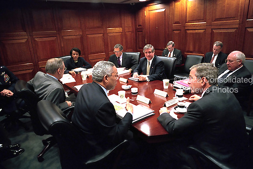 """United States President George W. Bush receives a briefing during a National Security Council (NSC) meeting inside the Situation Room of the White House in Washington, D.C. on Tuesday, October 2, 2001.  From the President's left: U.S. Secretary of State Colin Powell; U.S. Secretary of Defense Donald Rumsfeld; National Security Advisor Dr. Condoleezza Rice; Central Intelligence Agancy (CIA) Director George Tenet; White House Chief of Staff Andrew Card; Deputy National Security Advisor Stephen Hadley; Vice President Cheney's Chief of Staff Lewis """"Scooter"""" Libby; U.S. Vice President Dick Cheney; and President Bush..Mandatory Credit: Eric Draper - White House via CNP"""