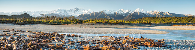 Driftwood on Gillespies Beach with Southern Alps, Mount Cook and Mount Tasman in background, Westland National Park, World Heritage Area, West Coast, New Zealand