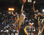 "Ole Miss guard Chris Warren (12) shoots as Murray State guard Jewuan Long (33) and Murray State forward Brandon Garrett (13) defend at the C.M. ""Tad"" Smith Coliseum in Oxford, Miss. on Wednesday, November 17, 2010."