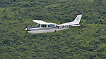 A Cessna T210 piloted by Rukang Chikomb flies through the skies over the Democratic Republic of the Congo. Part of the Wings of the Morning aviation ministry of The United Methodist Church, the program provides life-saving access to isolated rural communities. The photo was taken from another plane, a Cessna P210 piloted by Gaston Ntambo, that is part of the same program.