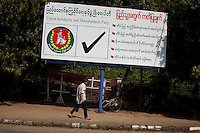 An election poster for the government-backed USDP (Union Solidarity and Development Party) in the old capital Rangoon (Yangon) prior to Burma's first multi-party election since 1990. However, the main pro-democracy party, the NLD (National League for Democracy), boycotted the poll and other opposition groups have alleged widespread voting fraud.
