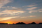 Sea of Cortez, Baja California, Mexico; Bahia de los Angeles (Los Angeles Bay) with colorful cloud formations at sunrise