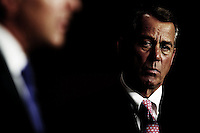 Speaker of the House John Boehner (R-OH) looks on while fellow Republicans address the media at a press conference on job creation on Capitol Hill on Thursday, May 26, 2011 in Washington.  (Photo by Jay Westcott/Politico)