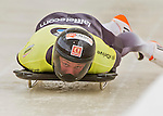 9 January 2016: Martins Dukurs, competing for Latvia, slides into his first run of the BMW IBSF World Cup Skeleton race at the Olympic Sports Track in Lake Placid, New York, USA. Martins Dukurs ended the day with a combined 2-run time of 1:48.28 and a resulting gold medal. Mandatory Credit: Ed Wolfstein Photo *** RAW (NEF) Image File Available ***