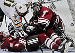 22 November 2011: University of Massachusetts Minutemen goaltender Jeff Teglia, a Sophomore from Bloomingdale, IL, has the puck get by in the third period. However after review, the goal was disallowed as University of Vermont Catamount forward H.T. Lenz was in the crease during the play at Gutterson Fieldhouse in Burlington, Vermont. The Catamounts defeated the Minutemen 2-1 in their annual pre-Thanksgiving meeting of the Hockey East season. Mandatory Credit: Ed Wolfstein Photo