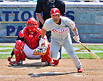 30 May 2011: Philadelphia Phillies third baseman Placido Polanco gets a single in the top of the 7th inning against the Washington Nationals at Nationals Park in Washington, District of Columbia. The Phillies defeated the Nationals 5-4 to take the first game of their 3-game series. Mandatory Credit: Ed Wolfstein Photo