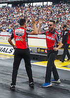 Mar 20, 2016; Gainesville, FL, USA; NHRA pro stock motorcycle rider Hector Arana Jr (right) celebrates with a crew member during the Gatornationals at Auto Plus Raceway at Gainesville. Mandatory Credit: Mark J. Rebilas-USA TODAY Sports