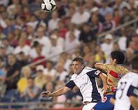 New England Revolution midfielder Chris Tierney (8) and Monarcas Morelia defender Enrique Perez (2) battle for head ball. Monarcas Morelia defeated the New England Revolution, 2-1, in the SuperLiga 2010 Final at Gillette Stadium on September 1, 2010.