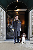 Christian Kaljaj, 20, a doorman for an apartment building on Park Avenue on the Upper East Side poses for a portrait on Wednesday April 5, 2011 with an English springer spaniel named Tuck who lives in the building...Danny Ghitis for The New York Times