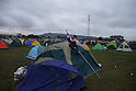 On the campus of Senshu University in Ishinomaki City in Miyagi Prefecture, a New Zealand flag hangs from one of the hundreds of tents housing volunteers from all over the world.  The school's track and field ground now plays host to NPOs such as Peaceboat, Shelterbox and Second Harvest, among many others.  The number of volunteers swelled greatly during the holiday period.