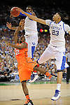 31 MAR 2012: Forward Anthony Davis (23) and teammate forward Terrence Jones (3) from the University of Kentucky block a shot attempt from guard Russ Smith (2) from the University of Louisville during the Semifinal Game of the 2012 NCAA Men's Division I Basketball Championship Final Four held at the Mercedes-Benz Superdome hosted by Tulane University in New Orleans, LA. Ryan McKeee/ NCAA Photos.