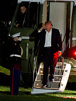United States President Donald J. Trump salutes the Marine Guard as he steps off Marine One on the South Lawn of the White House in Washington, DC as he returns from a weekend trip to the Trump National Golf Club in Bedminster, New Jersey on Sunday, May 7, 2017.<br /> Credit: Ron Sachs / Pool via CNP /MediaPunch