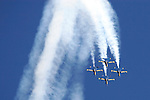 Blue Angel Diamond formation comes over the top of the loop during San Francisco Fleet Week activities. The U.S. Navy Blue Angel's fly the F/A-18 Hornet. Photographed 10/07