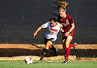 WINSTON-SALEM, NORTH CAROLINA - August 30, 2013:<br /> Charlyn Corral (9) of Louisville University breaks away from Katie Yensen (3) of Virginia Tech during a match at the Wake Forest Invitational tournament at Wake Forest University on August 30. The game ended in a 1-1 tie.