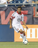 D.C. United forward Carlos Ruiz (20) looks to pass. In a Major League Soccer (MLS) match, the New England Revolution (blue) tied D.C. United (white), 0-0, at Gillette Stadium on June 8, 2013.