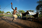 A boy jumps rope in the Gendrassa refugee camp in South Sudan's Upper Nile State. More than 110,000 refugees were living in four camps in Maban County in October 2012, but officials expected more would arrive once the rainy season ended and people could cross rivers that block the routes from Sudan's Blue Nile area, where Sudanese military has been bombing civilian populations as part of its response to a local insurgency. Conditions in the camps are often grim, with outbreaks of diseases such as Hepatitis E.