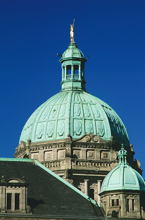 Close-up of cupola, dome and statue on top of Parliament Buildings, Legislature (F.M. Rattenbury, architect), in Victoria, BC.
