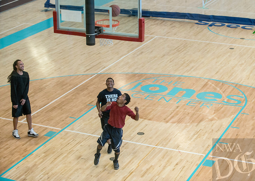 NWA Democrat-Gazette/ANTHONY REYES &bull; @NWATONYR<br /> Julian Finney, of Springdale, from left, Nicholas Joash, of Springdale, and Whidney Samueo, play basketball Friday, Jan. 23, 2015 in the gymnasium at the Jones in Springdale. The Center is marking 20 years of operation in 2015.