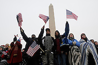Lloyd Hardy, 33 of Washington DC and his sons, Bernard Trowell, 15, and Travis Morris, 16 amongst the crowd which filled The Mall during the Opening Inaugural Celebration two days before the inauguration of Barack Obama as the 44th President of the United States. The Washington Monument stands behind them.