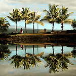 Sunrise greets visitors to the Queen Liliuokalani Gardens on Banyan Drive in Hilo on the Big Island, Hawaii.