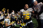 Alex Singh celebrates with the Mountain View High School football team after their 50-41 victory against Homestead High School in the team's first night game.<br />