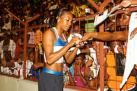 Sanya Richards signing autographs after her 400m win in a time of 50.60sec. at the Jamaica International Invitational Meet on Saturday, May 3rd. 2008. Photo by Errol Anderson,The Sporting Image.