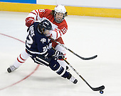 Curtis McKenzie (Miami - 16), Stevie Moses (UNH - 22) - The University of New Hampshire Wildcats defeated the Miami University RedHawks 3-1 (EN) in their NCAA Northeast Regional Semi-Final on Saturday, March 26, 2011, at Verizon Wireless Arena in Manchester, New Hampshire.